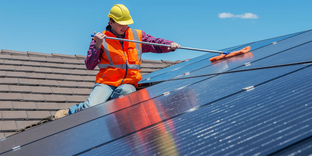 Hire a professional to clean solar panel